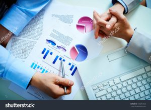 stock-photo-close-up-of-male-hand-pointing-at-business-document-during-discussion-130231046