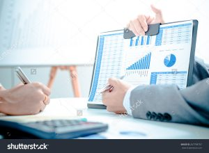 stock-photo-business-people-discussing-the-charts-and-graphs-showing-the-results-of-their-successful-teamwork-267798707
